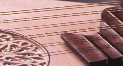 how to make guitar strings stop buzzing